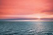 Sea Ocean Surface At Sunset Sunrise. Sunny Dawn Sky.