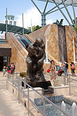 Tourists passing copy of The Thinker on Sentosa Island