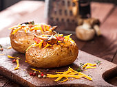 Baked stuffed potatoes with bacon, cheddar, mushrooms and dill