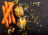 Wiener sausages and baked stuffed potatoes with cheese, cheddar, dill