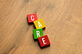 Care Word on Wooden Block