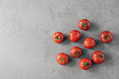 Fresh red tomatoes with water drops isolated over grey background with copy space. Natural organic food containing vitamins