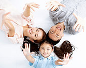 Top view of Happy asian Family lying on the floor