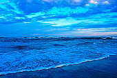 Secluded sandy Beach with waves at dramatic dawn – South Carolina, USA