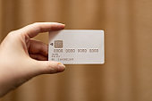 Woman hand holding white credit card
