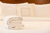 White towel on bed in hotel room