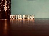 COFFEE BREAK, text on blue background