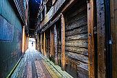 Narrow passage in Bryggen district in Bergen, Norway