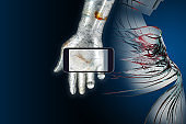 5G future image. A smartphone of the 5th generation mobile communication system placed in the palm of a metallic robot. The screen is emitting light. The background is a human body image of telemedicine and smart surgery.