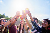 Friends making a cheers at the music festival