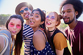 Selfie of five friends at the music festival