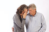 Senior Couple Cut Out Sadness Consoling