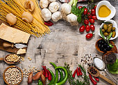 raw pasta, vegetables and various ingredients for traditional Italian cuisine