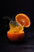 in the middle of an orange a splash of juice