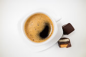 Cup of coffee espresso. Coffee cup and chocolate dessert on white background close up. Morning, breakfast, energy concept
