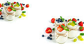 Fresh yogurt with berries in glass jars. Dairy products. Healthy food, dieting and breakfast concept. Long format for banner