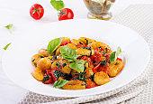 Gnocchi pasta in rustic style.  Italian cuisine. Vegetarian vegetable pasta. Cooking lunch. Gourmet dish.