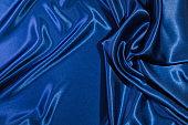 Close-up of a blue satin silk textile fabric