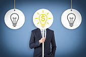 Finance idea concepts with light bulbs on a blue background