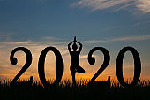 New year 2020 yoga concept woman pose