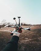 Man holds in his hand fpv copter