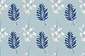 seamless leaf pattern, tropical leaves in blue colors for fabric