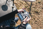A man manages FPV drone in VR glasses