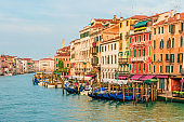 Beautiful view of Grand Canal in Venice,Italy from Rialto bridge with gondolas during sunrise