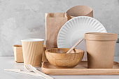 Eco friendly dishes. Disposable paper cups, dishes, fast food containers, wooden bowl and bamboo cutlery
