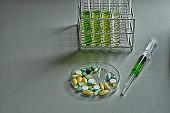 syringe, drug, equipment and glassware in scientific experiment laboratory