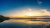 Panoramic shot of beautiful sunrise over lake. Extra high resolution image.