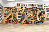 2020 new year education concept. Bookshelves with books in the form of text 2020 in school library.