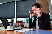 Businesswoman trying to concentrate on work