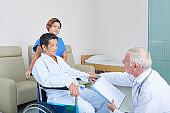 Doctor visiting senior patient in nursing home