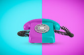 3d rendering of a retro rotary phone with contrast color on opposite contrast background.