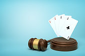 3d rendering of playing cards on round wooden block and brown wooden gavel on blue background