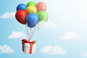 3d rendering of gift box with red ribbon tied to colorful balloons on blue sky background