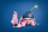 3d rendering of a piggy bank broken into pieces with a bomb with burning wick lying among the piggy shards.