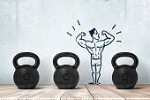 3d rendering of three kettlebells in a row on wooden floor with a little stylized image of athlete in underpants on the wall.