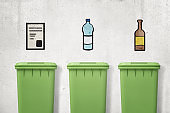 3d rendering of three green trash cans with drawings of paper, plastic and glass on wall above them showing which can is for which type of waste.