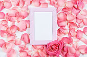 Valentines Day Greeting Card with Rose petals and photo frame. Mockup concept with space for text
