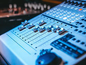 Professional Recording Studio. Interface of equipment for sound processing. Fader. Different modes of audio console. Working on song or voice