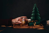 Woman drinking drink brandy whiskey or rum on ice Christmas feeling