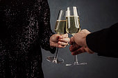 Man and woman in new years party toast close up