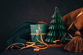 Christmas still with christmas gift and tree with home textiles