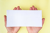 A woman hand hold a envelope