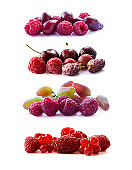 Pink berries isolated on white background. Ripe raspberries, cherries, mulberries, red currants red berries and grapes. Background of mix berries with copy space for text. Mix berries on white background. Berries isolated on white background.