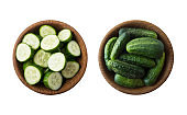 Fresh cucumbers in wooden bowl isolated on white background. Top view. Cucumbers with copy space for text. Cucumbers on white background.