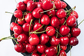 Cherries on a white background. Fresh cherries. Cherry fruit. Cherries with copy space for text. Top view. Background of cherries.