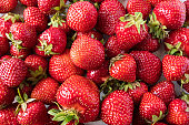 Background of fresh strawberries. Ripe strawberries. Ripe berries close-up. Various fresh summer berries. Background of red berries.